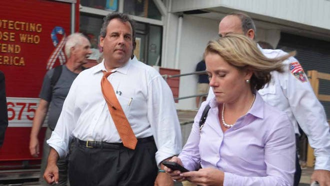Governor Christie and then Deputy Chief of Staff Bridget Anne Kelly walk at the scene of a boardwalk fire Sept. 12, 2013, in Seaside Heights.