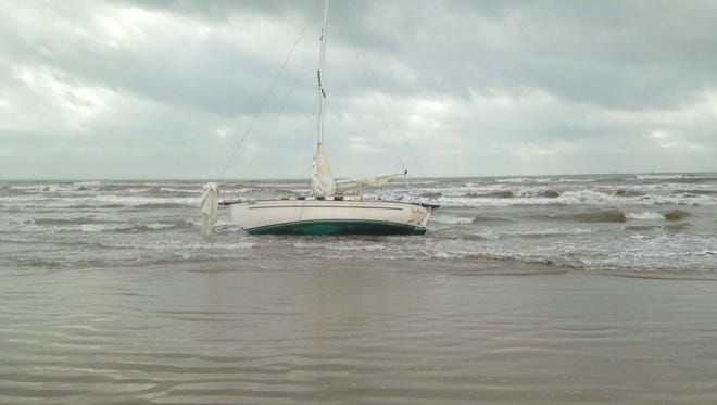 The grounded sailboat was located by the Coast Guard about 5 miles south of Port Aransas.
