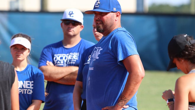 Oconee County head coach Zack Graham talks to his team after practice on Tuesday, July 28, 2020
