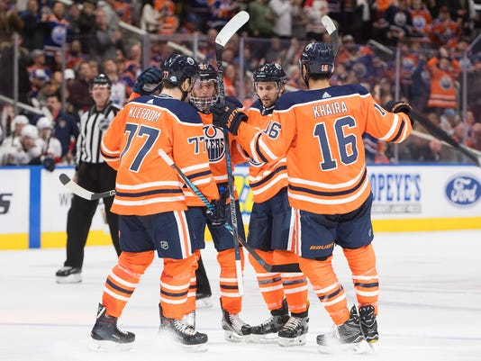 The Edmonton Oilers celebrate a goal against the Florida Panthers during second period NHL hockey action in Edmonton, Alberta, Monday Feb. 12, 2018. (Jason Franson/The Canadian Press via AP)