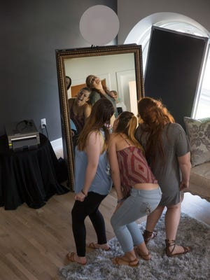 Some of the friends have some fun with the Photobooth that was provided for the event by Sounds To Go DJ. The daughters of Tamara Seidle and their friends were treated a free pampering service at Life As Fine Art Studio and Spa in Red Bank on May 20, 2016. It's for prom.