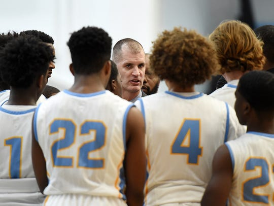 Cape Head Coach Stephen Re talks with his players at