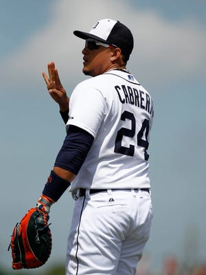 Detroit Tigers first baseman Miguel Cabrera (24) signals to the bench during the first inning of a spring training baseball game against the Miami Marlins at Joker Marchant Stadium.