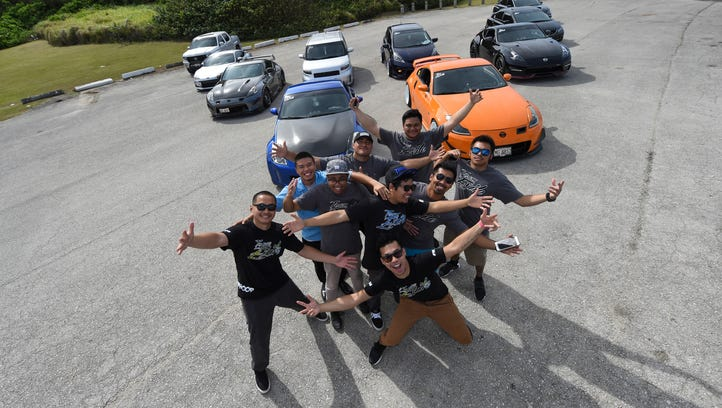 Team Exile poses for a picture in front of their cars