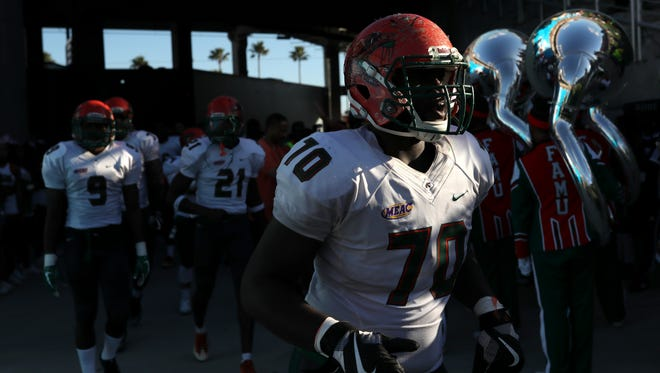 FAMU's Obinna Nwanko charges out of the tunnel for the second half against Bethune-Cookman during the Rattlers 29-24 Florida Classic loss at Camping World Stadium in Orlando Saturday, Nov. 18, 2017.