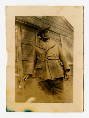 "In a photo provided by the Bentley Historical Library, James ""Big Jim"" Richardson is photographed outside a cabin in Michigan in 1936."
