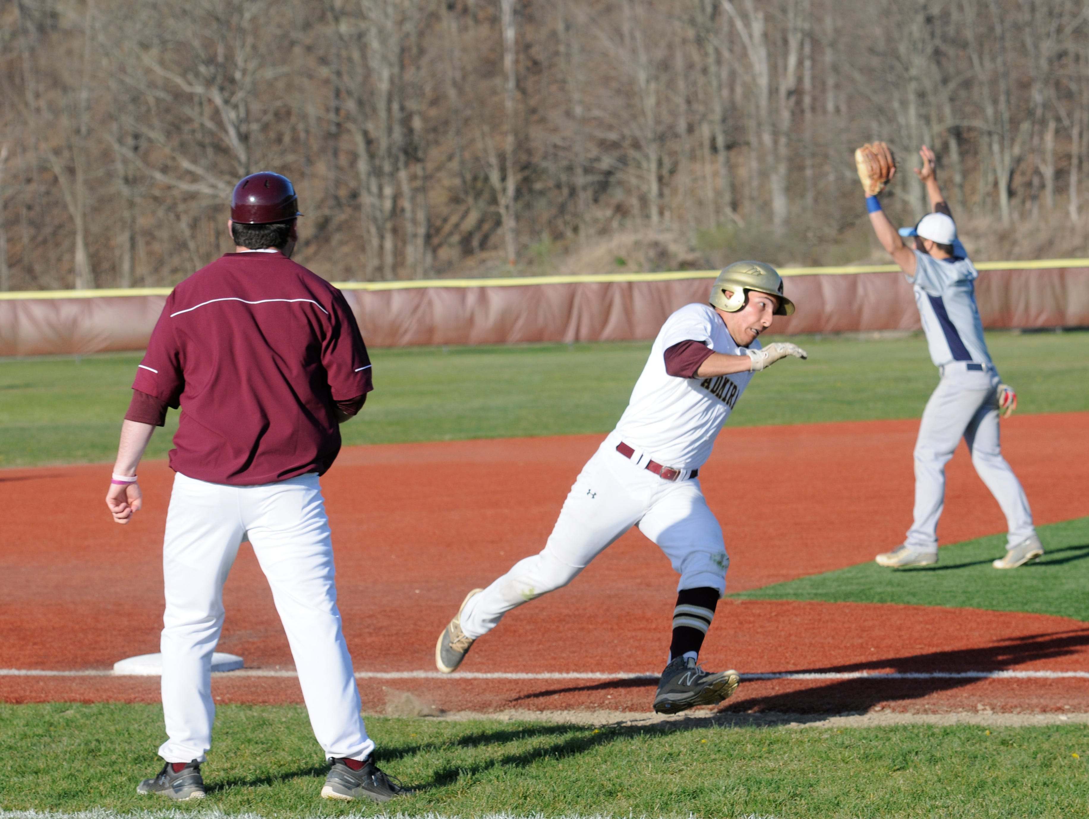 Arlington's Connor Chiulli rounds third base from a single hit by Simon Alvarez to make it home during Tuesday's home game versus John Jay.