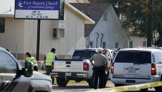 Law enforcement officials work near the scene of a fatal shooting at the First Baptist Church in Sutherland Springs, Texas, on Nov. 5, 2017.