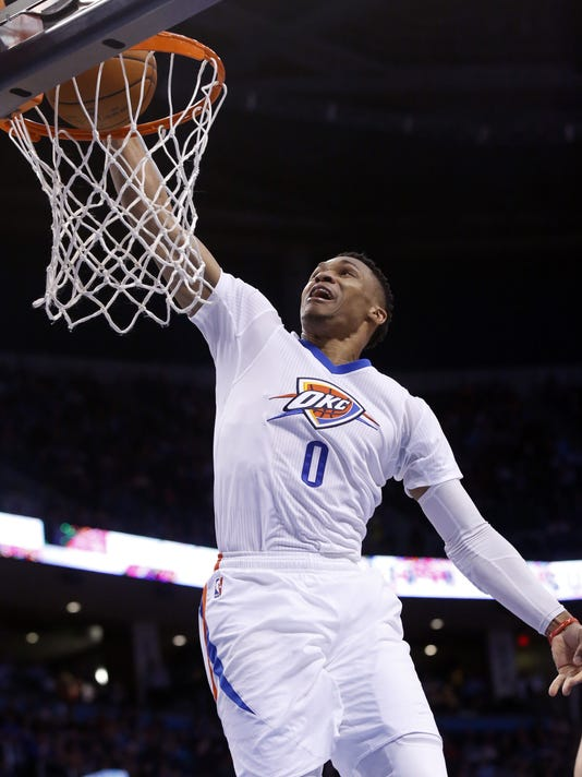 FILE - In this March 22, 2016, file photo, Oklahoma City Thunder guard Russell Westbrook (0) dunks during an NBA basketball game against the Houston Rockets  in Oklahoma City. Westbrook is no longer sharing the NBA marquee in Oklahoma City after the Thunder lost much of their identity when free agent Kevin Durant chose to join the Golden State Warriors on Monday, July 4, 2016. (AP Photo/Sue Ogrocki, File)