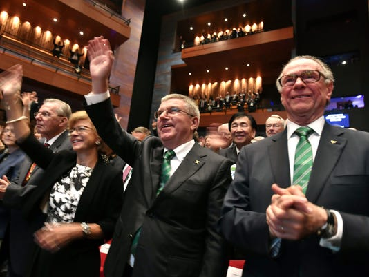 International Olympic Committee President Thomas Bach, second right, and President of the Rio 2016 Olympic Organizing Committee Carlos Arthur Nuzman, right, applaud during the opening ceremony of the 129th International Olympic Committee session, in Rio de Janeiro on August 1, 2016, ahead of the Rio 2016 Olympic Games. (Fabrice Coffrini/Pool Photo via AP)