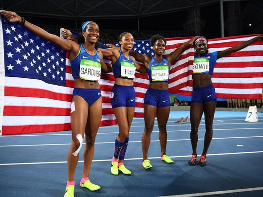 (From left) Eastern grad English Gardner, Allyson Felix, Tianna Bartoletta and Tori Bowie celebrate after they won the women's 4x100 meter relay final at the 2016 Olympic Games in Rio. Gardner suffered a major knee injury in 2017 and has worked her way all the way back and is competing at the 2019 world championships in Qatar beginning Sept. 27.
