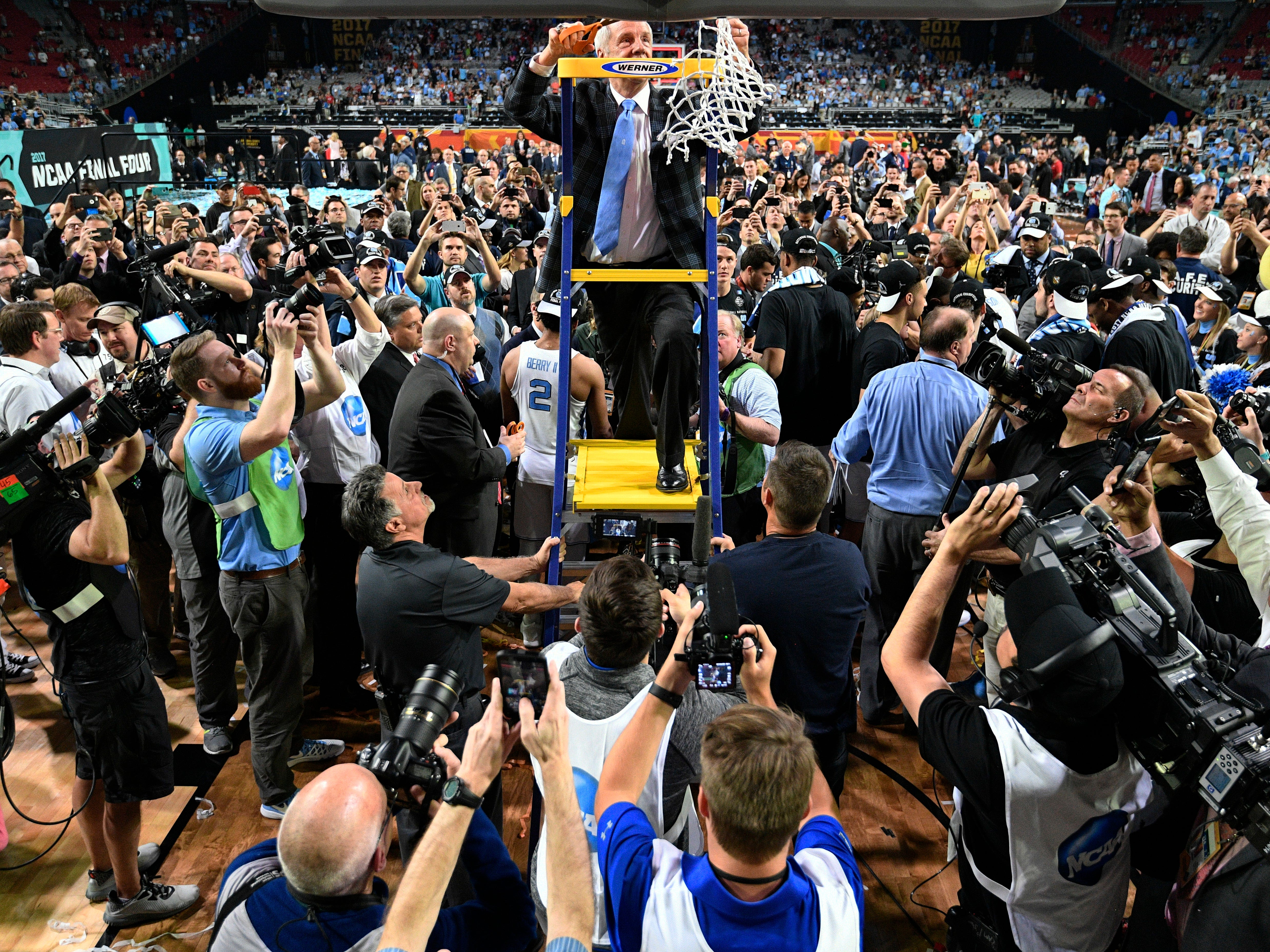 North Carolina head coach Roy Williams cuts the net after the finals of the Final Four NCAA college basketball tournament against Gonzaga, Monday, April 3, 2017, in Glendale, Ariz. North Carolina won 71-65. (AP Photo/Chris Steppig, Pool)