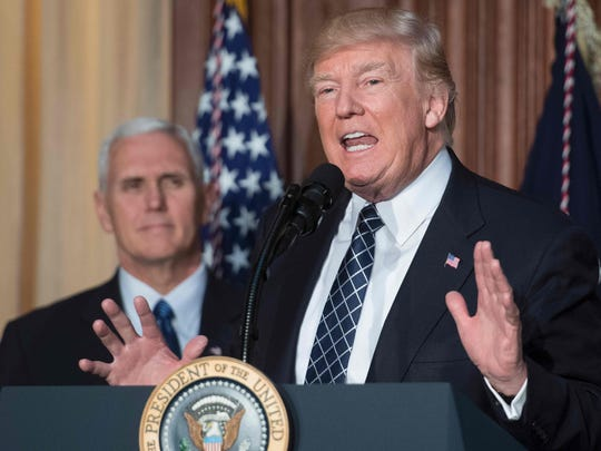 President Donald Trump speaks before signing the Energy