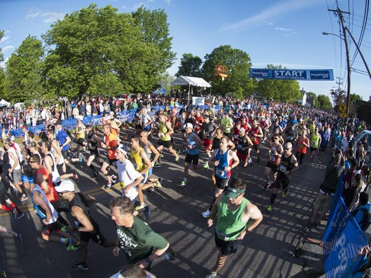 Runners make their way down Battery Street at the start of the race during the 2017 Vermont City Marathon on Sunday May 28, 2017 in Burlington.