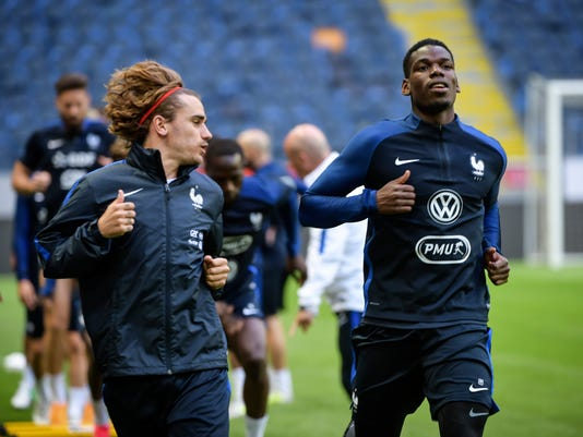France's national soccer team players Antoine Griezmann, left, and Paul Pogba in action during a training session on the eve of the their World Cup qualification soccer match against Sweden at Friends Arena in Stockholm, Thursday June 8, 2017. (Henrik Montgomery/TT via AP)
