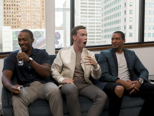 Anthony Mackie, left, Will Poulter, and Laz Alonso share a laugh at the Monday press conference. Poulter, a British actor, convincingly portrayed racist police officer Philip Krauss, an amalgam of different Detroit officers involved in the Algiers incident.