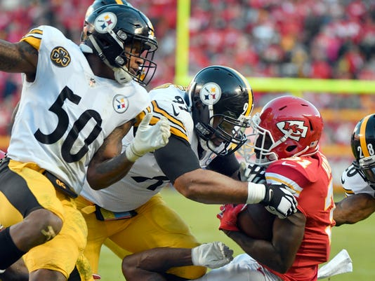 Kansas City Chiefs running back Akeem Hunt (31) is tackled by Pittsburgh Steelers defensive end Cameron Heyward (97), safety Sean Davis (28) and linebacker Ryan Shazier (50) during the second half of an NFL football game in Kansas City, Mo., Sunday, Oct. 15, 2017. (AP Photo/Ed Zurga)