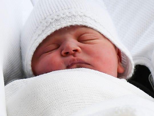 Britain's Prince William, Duke of Cambridge carries