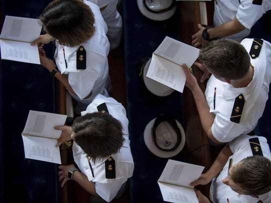 In this image provided by the U.S. Navy, Midshipmen attend the funeral service for Sen. John McCain, R-Ariz., at the United States Naval Academy Chapel, Sept. 2, 2018, in Annapolis, Md. McCain was buried at the cemetery at the Naval Academy after the service. (Kenneth D. Aston Jr./U.S. Navy via AP)