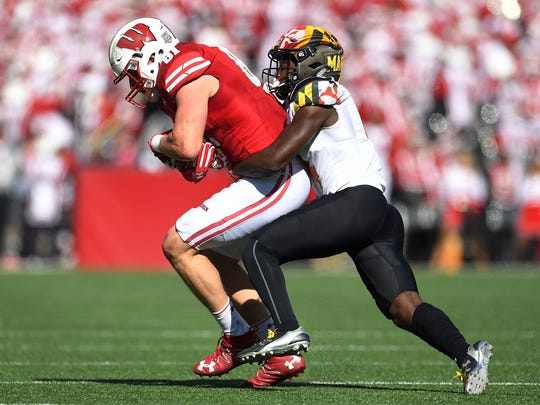 Maryland safety Darnell Savage Jr. brings down Wisconsin's Troy Fumagalli during an Oct. 21, 2017 game in Madison.
