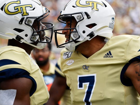 Georgia Tech wide receiver Jalen Camp (1) celebrates his touchdown with Georgia Tech quarterback Lucas Johnson (7) during the second half of an NCAA college football game against the Citadel, Saturday, Sept. 14, 2019, in Atlanta. The Citadel won 27-24 in overtime. (AP Photo/Mike Stewart)