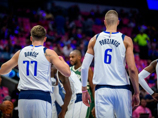 Oct 11, 2019; Dallas, TX, USA; Dallas Mavericks forward Luka Doncic (77) and forward Kristaps Porzingis (6) in action during the game between the Mavericks and the Bucks at the American Airlines Center. Mandatory Credit: Jerome Miron-USA TODAY Sports