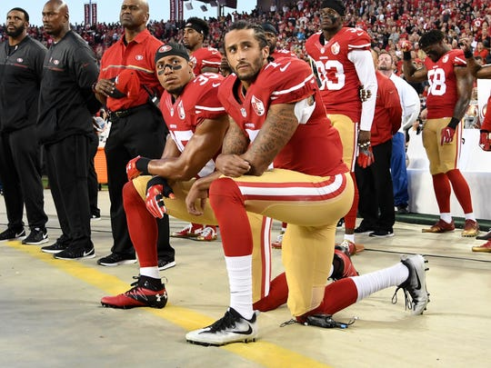 Colin Kaepernick, No. 7, during his protest days