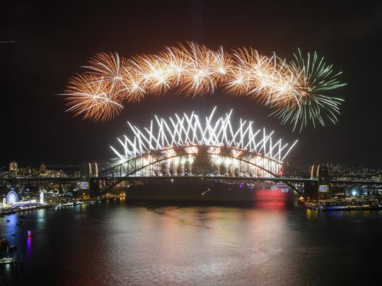 Midnight fireworks explode over the Sydney Harbour Bridge during New Year's eve celebrations in Sydney, Tuesday, Jan.1, 2019. (Lukas Coch/AAP Images via AP)