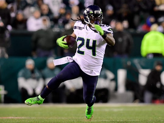 PHILADELPHIA, PENNSYLVANIA - JANUARY 05: Marshawn Lynch #24 of the Seattle Seahawks carries the ball for a first down in the third quarter of the NFC Wild Card Playoff game against the Philadelphia Eagles  at Lincoln Financial Field on January 05, 2020 in Philadelphia, Pennsylvania. (Photo by Steven Ryan/Getty Images)