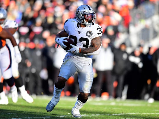 Dec 29, 2019; Denver, Colorado, USA; Oakland Raiders running back DeAndre Washington (33) carries the ball in the second quarter against the Denver Broncos at Empower Field at Mile High. Mandatory Credit: Ron Chenoy-USA TODAY Sports