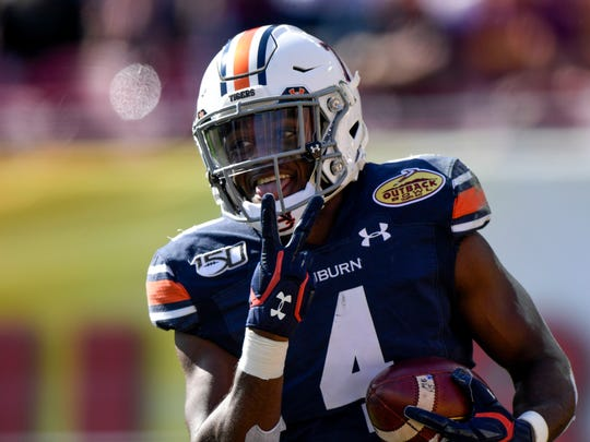 Jan 1, 2020; Tampa, Florida, USA; Auburn Tigers defensive back Noah Igbinoghene (4) reacts to a touchdown during the first quarter against the Minnesota Golden Gophers at Raymond James Stadium. Mandatory Credit: Douglas DeFelice-USA TODAY Sports