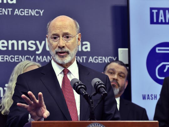 FILE - In this March 12, 2020, file photo, Gov. Tom Wolf of Pennsylvania speaks at a news conference at Pennsylvania Emergency Management Headquarters in Harrisburg, Pa. Wolf is struggling to fight against a Republican revolt over his stay-at-home orders and business shutdowns. Egged on by state GOP lawmakers, counties have threatened to defy his orders while at least a few business owners have reopened their doors despite his warnings. (AP Photo/Marc Levy, File)