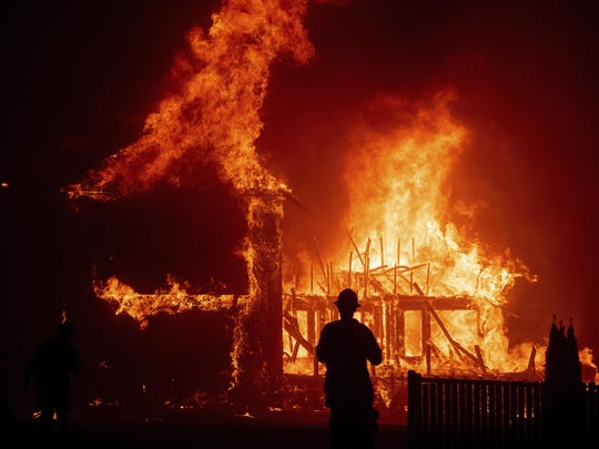 A home burns as the Camp Fire rages through Paradise, CA on Thursday, Nov. 8, 2018. (PHOTO BY NOAH BERGER]