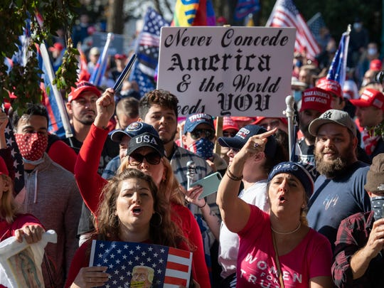 Supporters of President Donald Trump demonstrate and march toward the Supreme Court during the so-called Million MAGA March on Saturday in Washington.