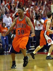 Robinson (50) reacts after scoring near the end of
