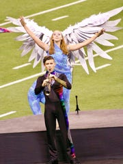 Castle Marching Knights - Castle Marching Knights competed at the Bands of America Grand National Championships in hopes of reaching the national championship finals for the second year in a row.  Pictured are color guard member Olivia Dean and soloist Matthew Waggoner.