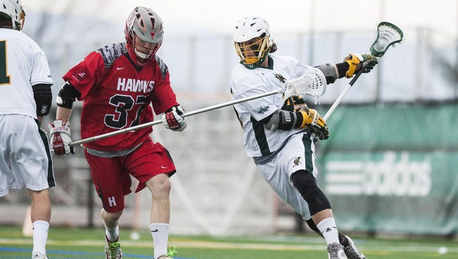 Vermont's Ian MacKay, right, seen in action during the 2015 season, surpassed 100 career goals Saturday in the Catamounts' 14-10 win.