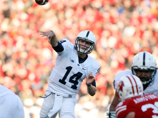 Penn State Nittany Lions quarterback Christian Hackenberg (14) throws a pass as his team plays the Wisconsin Badgers at Camp Randall Stadium last season.
