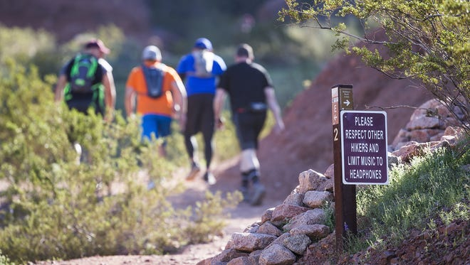 Hikers make their way up the trail in Echo Canyon on Camelback Mountain on March 7, 2017.