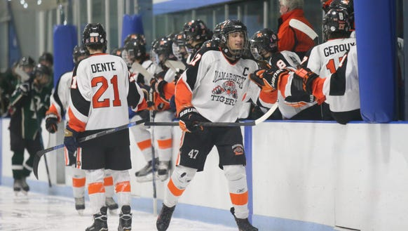 Mamaroneck's Chris Watroba (47) works the boards after