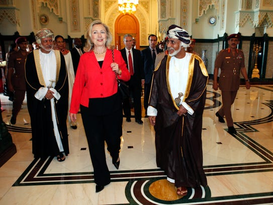 Then-Secretary of State Hillary Clinton walks with