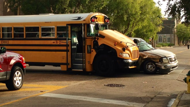 A Rapides Parish school bus and an SUV collided Friday morning at an intersection of Jackson Street in downtown Alexandria.