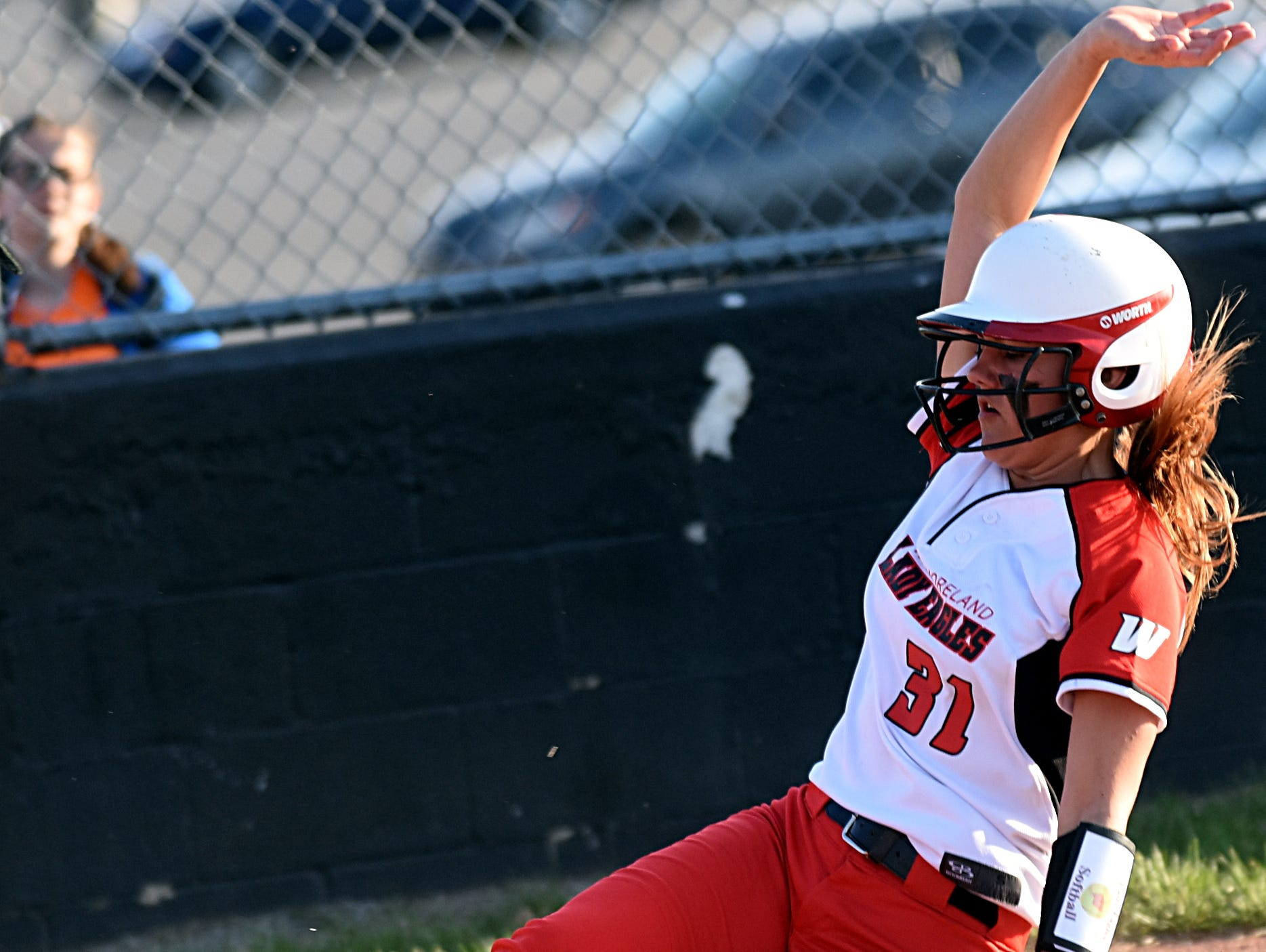 Westmoreland High junior Kimi Richardson slides safely into home plate during the second inning.