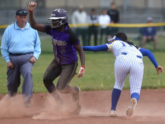 Spanish Springs' Amidori Anderson (3) slides safely into second base past the tag by Reed's Carla Hernandez during their softball game in Sparks on May 6.