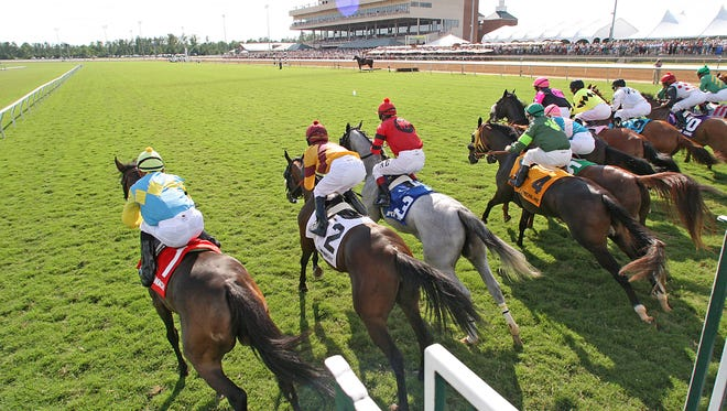 A race starts at Colonial Downs in New Kent County in 2007. Chicago's Revolutionary Racing is taking over the dormant track and plans to offer video horse-race betting in addition to live races.