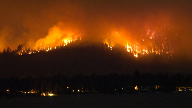 Flames in the Angora Fire raced across the tinder-dry forest, consuming structures and threatening Lake Tahoe's beauty on June 24, 2007. The Angora Fire destroyed more than 250 homes outside South Lake Tahoe.