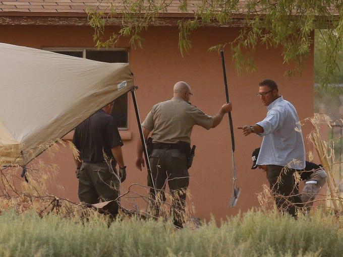 Pinal sheriff's deputies and investigators dig behind