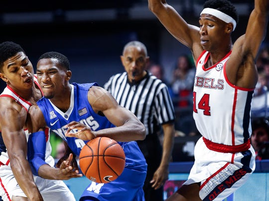 University of Memphis guard Jeremiah Martin (middle) loses control of the ball while double-teamed by Ole Miss defenders Breein Tyree (left) and Rasheed Brooks (right) during first half action at The Pavilion in Oxford, Mississippi, Saturday.