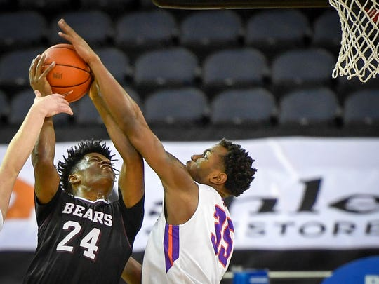 Missouri State's Alize Johnson (24) is blocked by University of Evansville's John Hall (35) as the University's of Evansville Purple Aces play the Missouri State Bears at the Ford Center Wednesday, January 10, 2018.