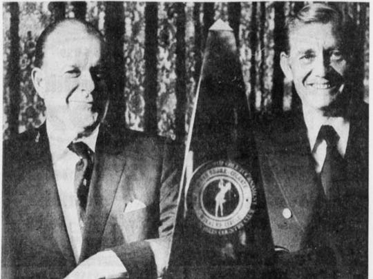 From left, David Foster, president of Colgate Palmolive Co. and Max Genet Jr., president of Mission Hills Country Club view the Tiffany trophy designed for the inaugural Colgate-Dinah Shore Winners Circle in 1972.